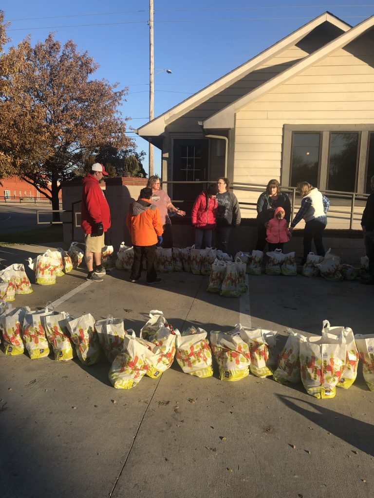 Thanksgivers Filling Bags And Handing Out Coats For Homeless On Thanksgiving Morning